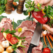 Sliced fresh raw meat  on board with vegetables — Stock Photo