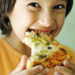 Boy eating pizza and smiling, closeup — Stock Photo
