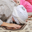 Muslim girls praying at mosque — Stock Photo