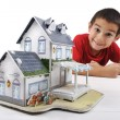 Little boy with little home, conceptual image (house made of paper) — Stock Photo