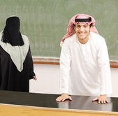 Smiling young success man, arabic traditional clothes, education — Stock Photo