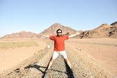 Man on train tracks — Stock Photo