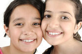 Two girl sisters best friends together smiling — Stock Photo