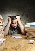 Panic in office or library. Businessman on the table. — Stock Photo