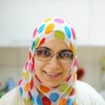 Beautiful muslim woman standing in kitchen — Stock Photo #12183951