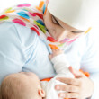 Beautiful baby of two months old in his muslim mothers hands. — Stock Photo #12233475