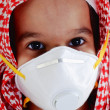 Cute arabic muslim boy wearing disposable face mask — Stock Photo