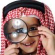 Arabic little kid boy with Magnifying glass — Stock Photo