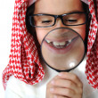 Arabic little kid boy with Magnifying glass - Stock Photo