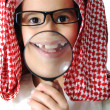 Stock Photo: Arabic little kid boy with Magnifying glass