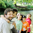Happy father and children together outdoor — Stock Photo