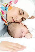Beautiful baby of two months old in his muslim mothers hands. — Stock Photo