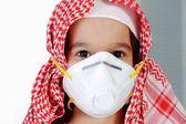 Cute arabic muslim boy wearing disposable face mask — Stock Photo