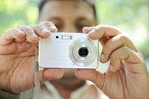 Man with photo camera — Stock Photo