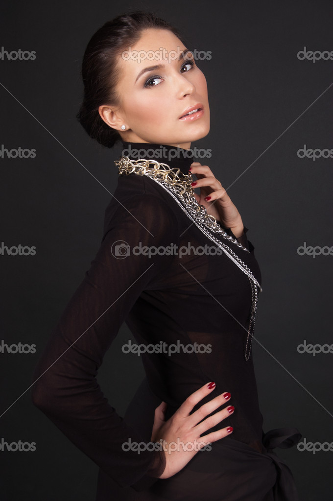 Fashion photo of a young woman isolated on black — Stock Photo #11407144