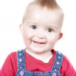 1 year old baby girl smiling at the camera — Stock Photo