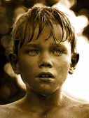 Vintage portrait of a child with water drop on face — Stock Photo