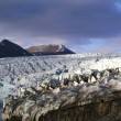 Stock Photo: Calving glacier frot