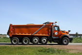 Orange dump truck — Stock Photo
