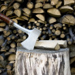 Hatchet sticking in a stump — Stock Photo