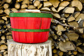 Red and green bushel basket — Stock Photo