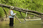 Trout fisherman — Stock Photo