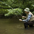 Fisherman in waders — Stock Photo