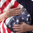 USA flag held by a veteran - Stock Photo