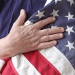 American flag with the hand of a veteran — Stock Photo #10927606