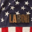 Labor word on American flag — Stock Photo