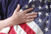 American flag with the hand of a veteran — Stock Photo