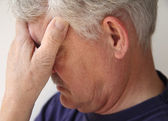 Older man depressed or grieving — Stock Photo