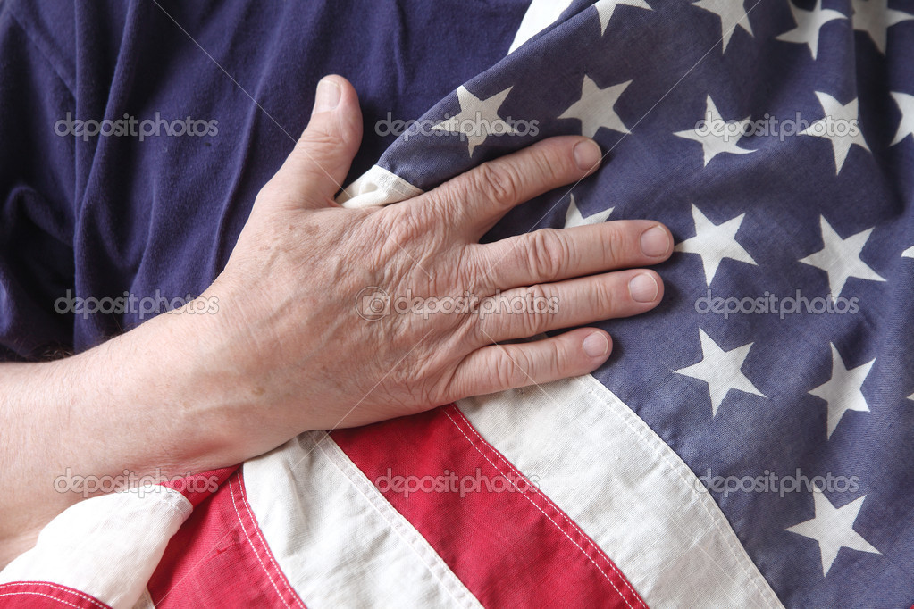 A man&#039;s hand on a USA flag against his chest  Stock Photo #10927606
