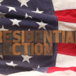The words presidential election on a USA flag — Stock Photo