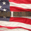 Stock Photo: Social security words on USflag