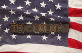 USA flag with the word technology — Stock Photo