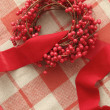 Stock Photo: Christmas berries and ribbon on plaid