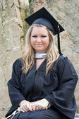 Female College Graduate Portrait in Cap and Gown — Stock Photo