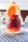Cold sangria in the glass jug with condensate — Stock Photo