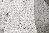 Abstracte stenen achtergrond met natte en droge ruimte — Stockfoto