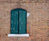 Old window in brick wall — Stock Photo