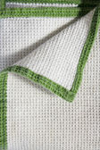 Kitchen towel with green fringe and turned-in angle, folded like envelope , close up — Stock Photo