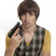 A young man with a gun in his hand — Stock Photo #11688502