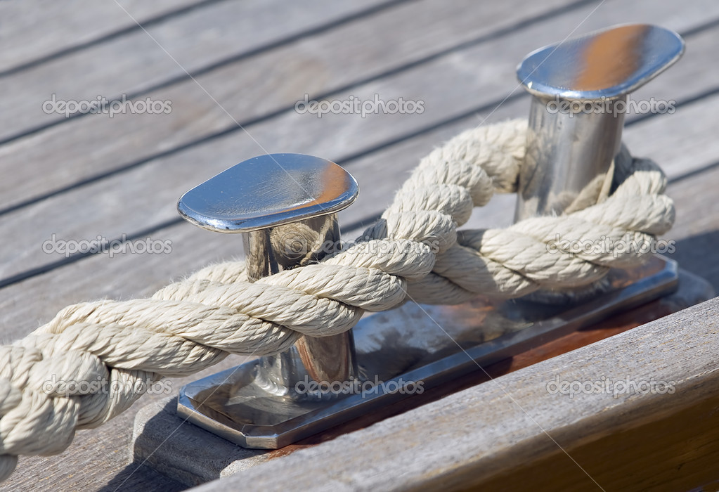 Boat rope tied up on a bitt  Stock Photo #11963905