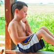 Royalty-Free Stock Photo: Small Boy Taking a Break on a Hot Summer Day