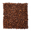 Coffee beans organised into foursquare - Stock Photo