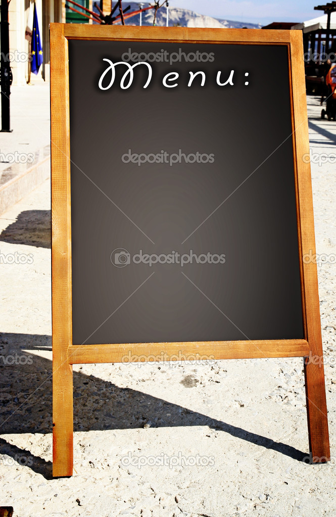 Restaurant menu chalkboard on the street  Stock Photo #10836748