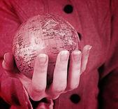 Globe in a girl's hands — Stock fotografie