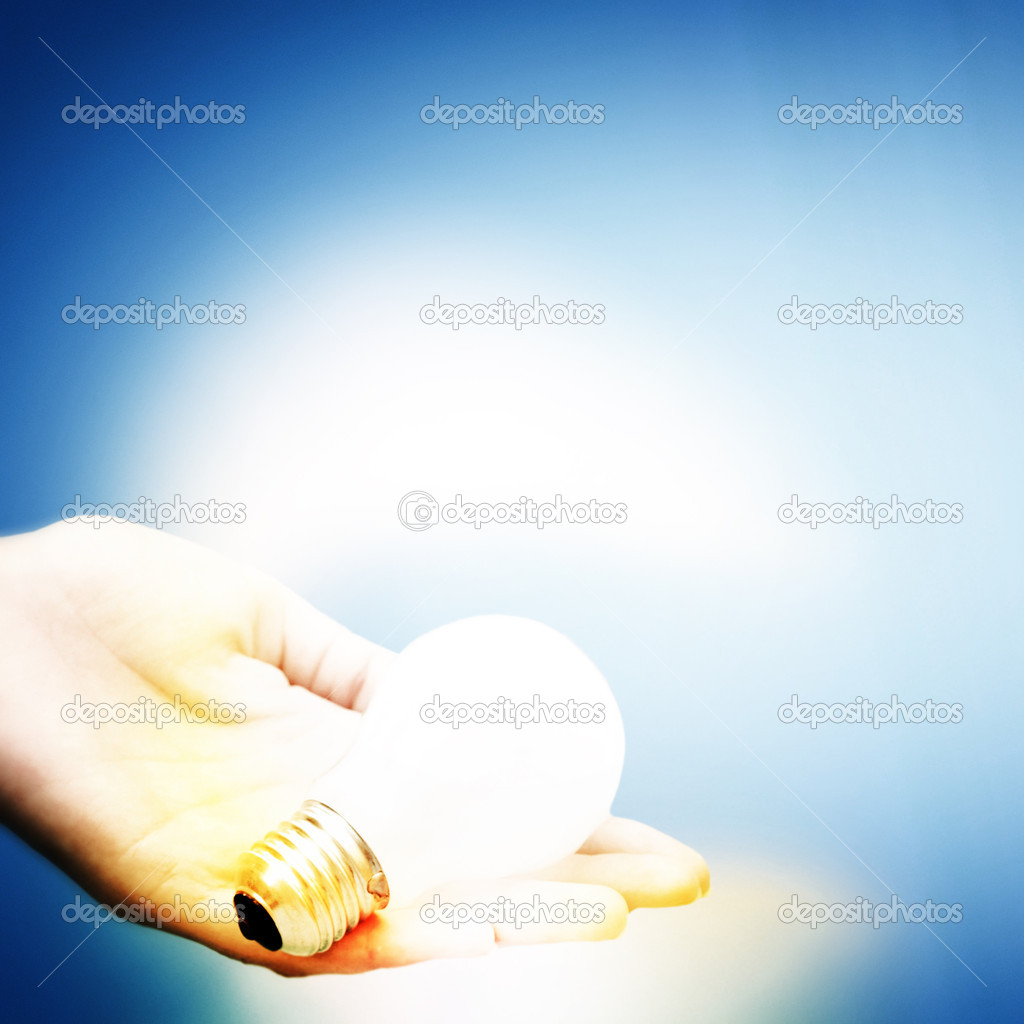 Background with lit lightbulb. Isolated on blue — Stock Photo #11431903