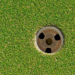 Closeup of Golf Cup or Hole - Stock Photo
